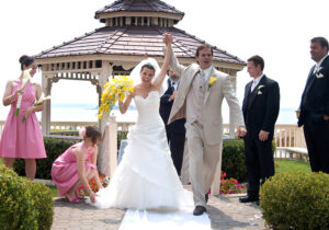Wedding Photographer Los Angeles of bride and groom joyfully walking down isle after ceremony