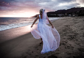 Wedding Photographer Los Angeles of Bride walking on the beach in Malibu, CA